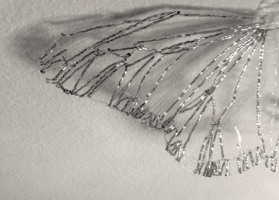 beaded bird's wing